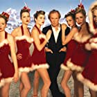 Bill Nighy, Sarah Holland, Meredith Ostrom, Clare Bennett, Sarah Atkinson, Vicki Murdoch, Katherine Poulton, and Tuuli Shipster in Love Actually (2003)