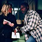 Director Gabrielle Savage Dockterman discusses a scene with Danny Glover on the set of WOODCUTTER.