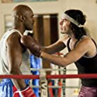 Evander Holyfield and Russell Brand in Arthur (2011)
