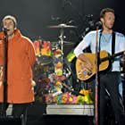 Liam Gallagher and Chris Martin at an event for One Love Manchester (2017)