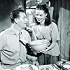 John Wayne and Dona Drake in Without Reservations (1946)