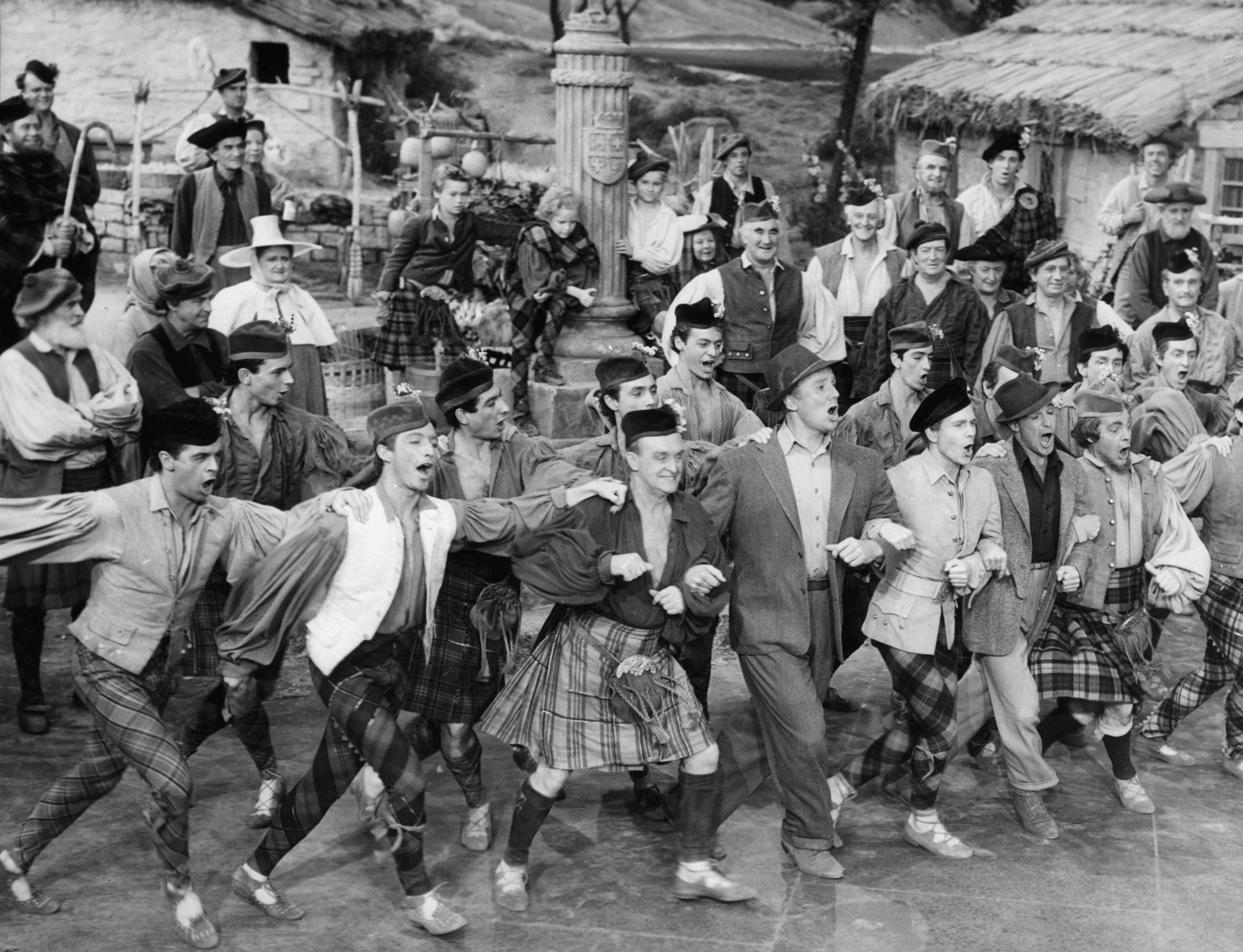 Gene Kelly, Van Johnson, Buddy Bryan, Lorna Jordon, Eddie Quillan, Gregor Momdjian, and Jimmy Brooks in Brigadoon (1954)