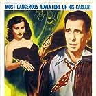 Humphrey Bogart and Florence Marly in Tokyo Joe (1949)