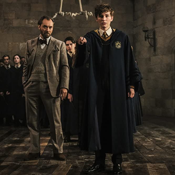 Jude Law and Joshua Shea in Fantastic Beasts: The Crimes of Grindelwald (2018)