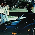 """Eddie Murphy and Don Simpson with Ferrari from """"Beverly Hills Cop""""."""