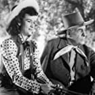 Tom Chatterton and Peggy Stewart in Code of the Prairie (1944)