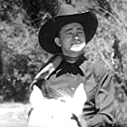 Tex Ritter and White Flash in Rollin' Plains (1938)