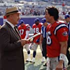 Gene Hackman as Coach McGinty and Keanu Reeves as Shane Falso