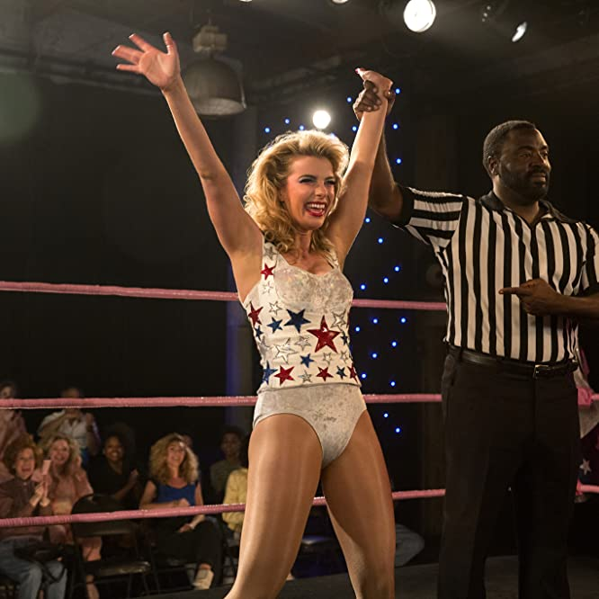 Bashir Salahuddin and Betty Gilpin in GLOW (2017)