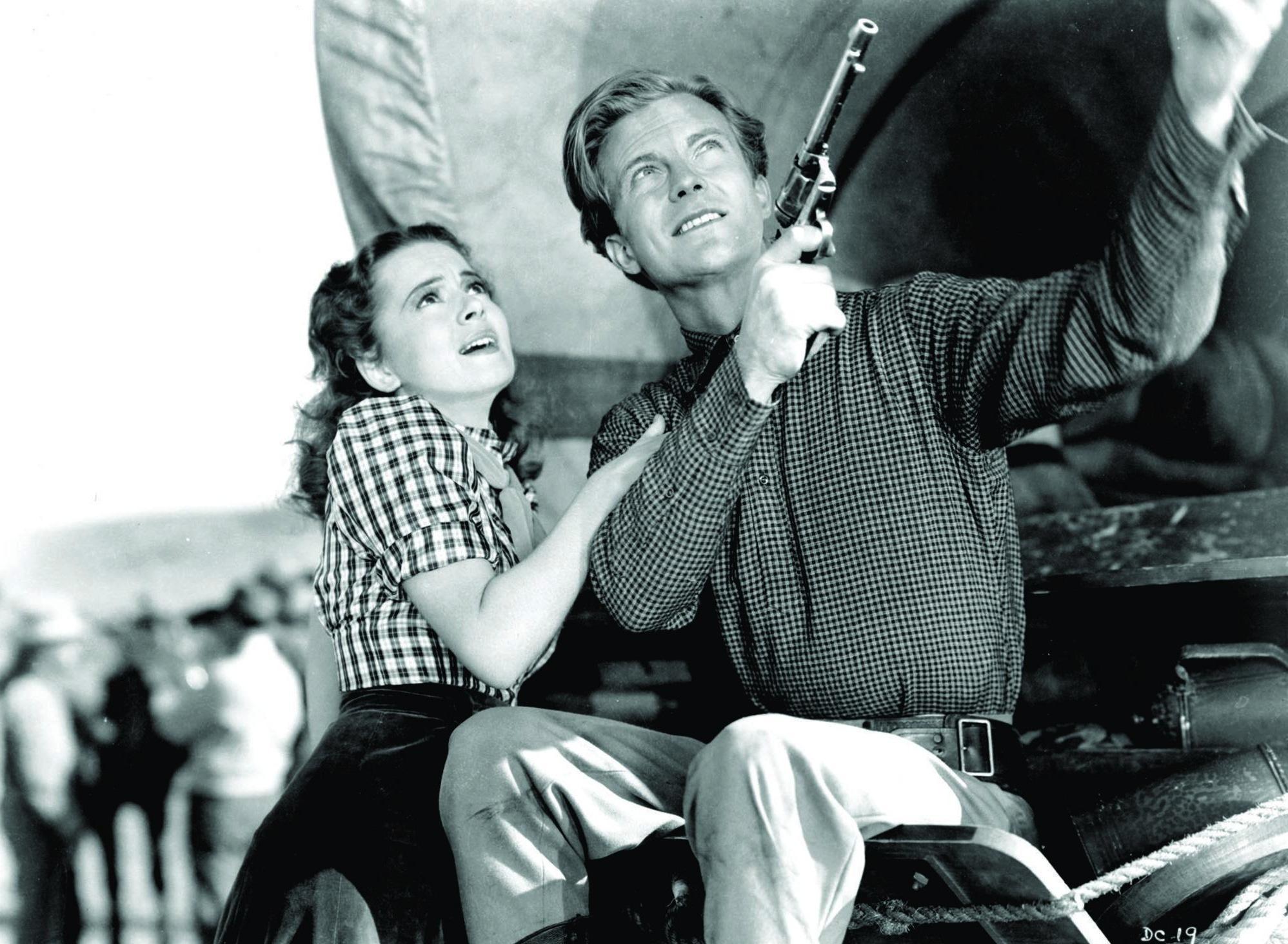 Olivia de Havilland and William Lundigan in Dodge City (1939)