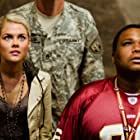 Anthony Anderson and Rachael Taylor in Transformers (2007)
