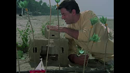"""Ashok Tandon (Dharmendra) is a bank manager, and is in love with Deepa (Raakhee), and both are soon to be married. However, Ashok is arrested for theft from the bank. He asks Deepa to look after his mom (Leela Chitnis), which she agrees to do so. He is sentenced to prison for several years. After his release he finds out that his mother has passed away; Deepa is married and has re-located; and he was framed by his colleagues at the bank. Devastated but still honest, he is befriended by Raja Ranbir Singh, who gives him a job, as well a new identity. Ashok now becomes Bikram Singh, and he must seek out Deepa, and his shrewd and calculating colleagues at the bank to extract vengeance.""""Jhil mil sitaron ka aangan hoga, rim jhim barasta sawan hoga...."""", is still popular."""