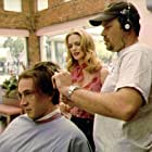 Director James B. Rogers shows Heather Graham how to give a bad haircut