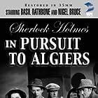 Basil Rathbone, Nigel Bruce, Rosalind Ivan, Marjorie Riordan, and Leslie Vincent in Pursuit to Algiers (1945)