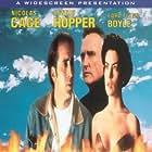 Nicolas Cage, Dennis Hopper, and Lara Flynn Boyle in Red Rock West (1993)