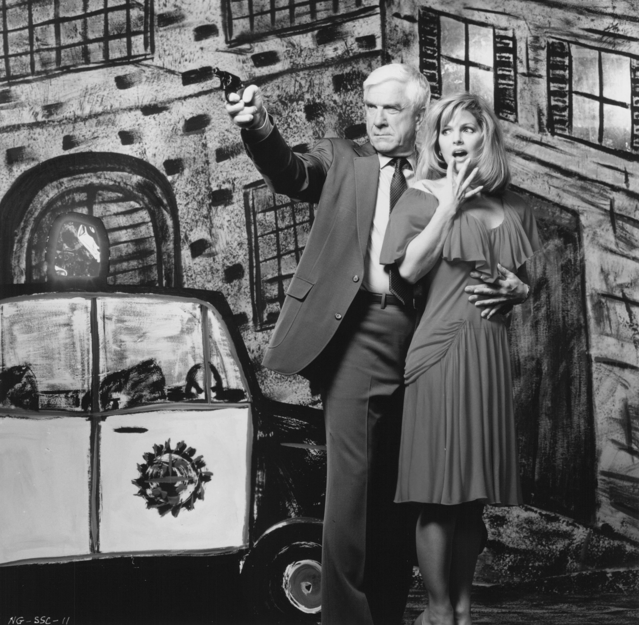 Leslie Nielsen and Priscilla Presley in The Naked Gun: From the Files of Police Squad! (1988)