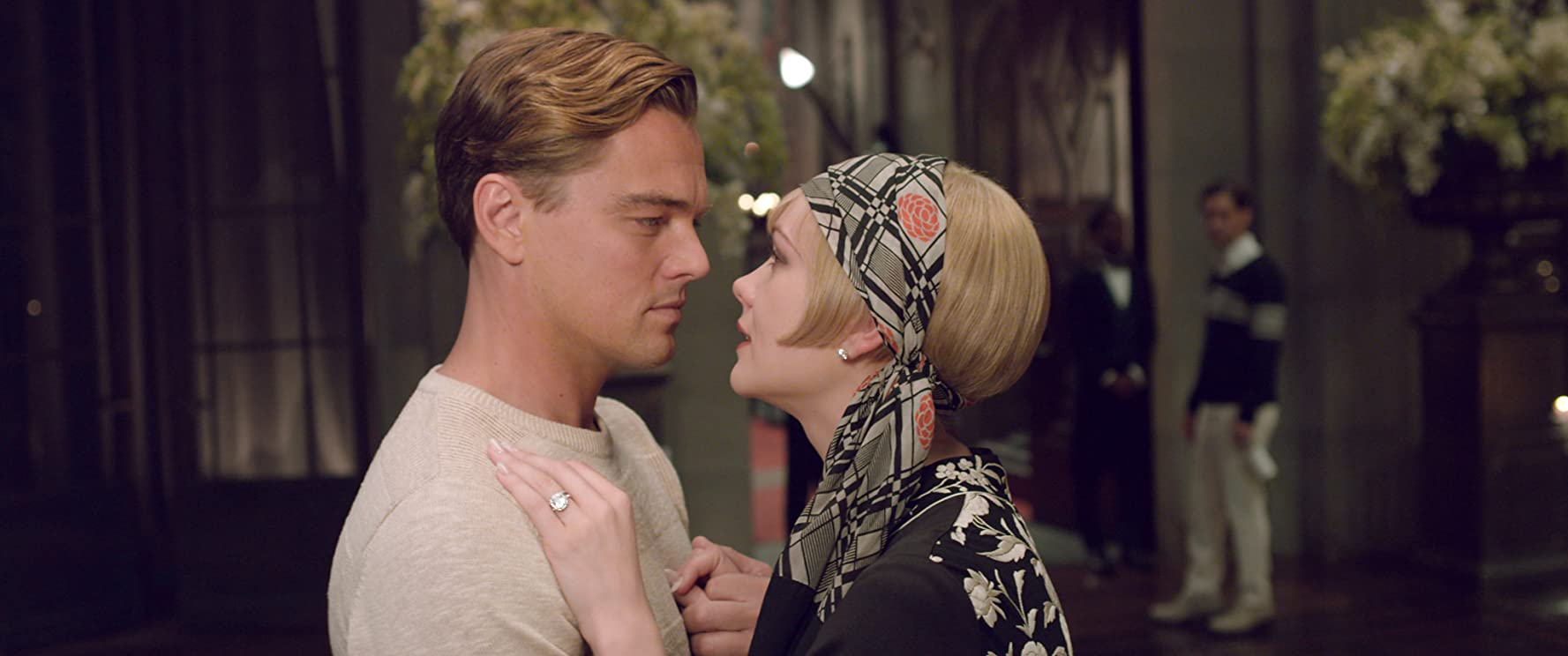 Leonardo DiCaprio, Tobey Maguire, and Carey Mulligan in The Great Gatsby (2013)