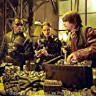 Blade (Wesley Snipes, left), Nyssa (Leonor Varela, center) and Scud (Norman Reedus) review their new weapons in New Line Cinema's action thriller, BLADE II.