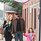 Sean Faris, Alex Paxton-Beesley, Josie Gallina, and Lucy Gallina in Christmas with Holly (2012)