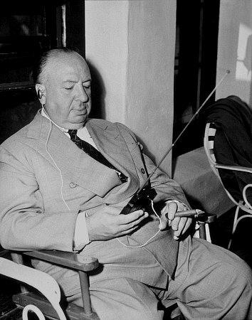 "Alfred Hitchcock on teh set of ""Strangers on a Train."" 1950 Warner Bros."