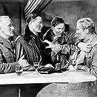 Errol Flynn, Donald Crisp, Carl Esmond, and Peter Willes in The Dawn Patrol (1938)