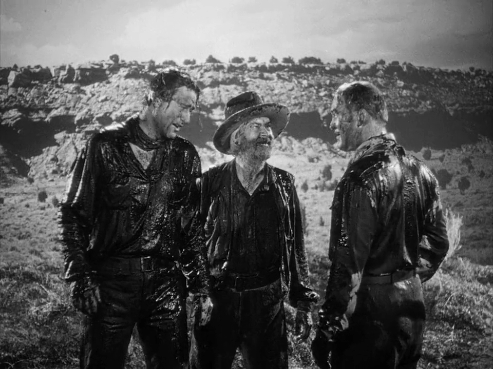 John Wayne, Albert Dekker, and George 'Gabby' Hayes in In Old Oklahoma (1943)