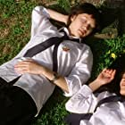 Yat Ning Chan and Joman Chiang in Hu die (2004)