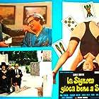 La signora gioca bene a scopa? (1974)