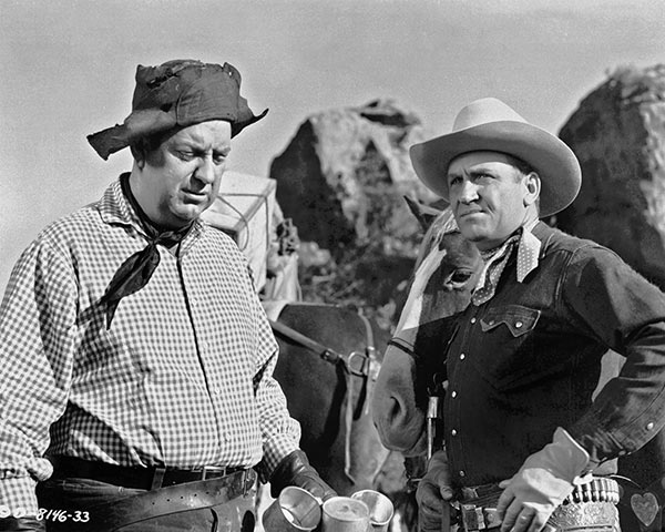 Gene Autry and Smiley Burnette in Pack Train (1953)