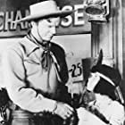 Don 'Red' Barry and Tommy Cook in Adventures of Red Ryder (1940)