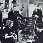 Donald Douglas, Kenne Duncan, Richard Fiske, Warren Hull, and Iris Meredith in The Spider's Web (1938)