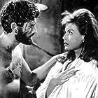 John Drew Barrymore and Eva Bartok in Ti aspetterò all'inferno (1960)