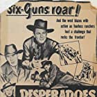 Judy Clark, Tom Keene, and Lee Phelps in Desperadoes of the West (1950)