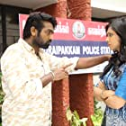 Vijay Sethupathi and Madonna Sebastian in Kadhalum Kadanthu Pogum (2016)