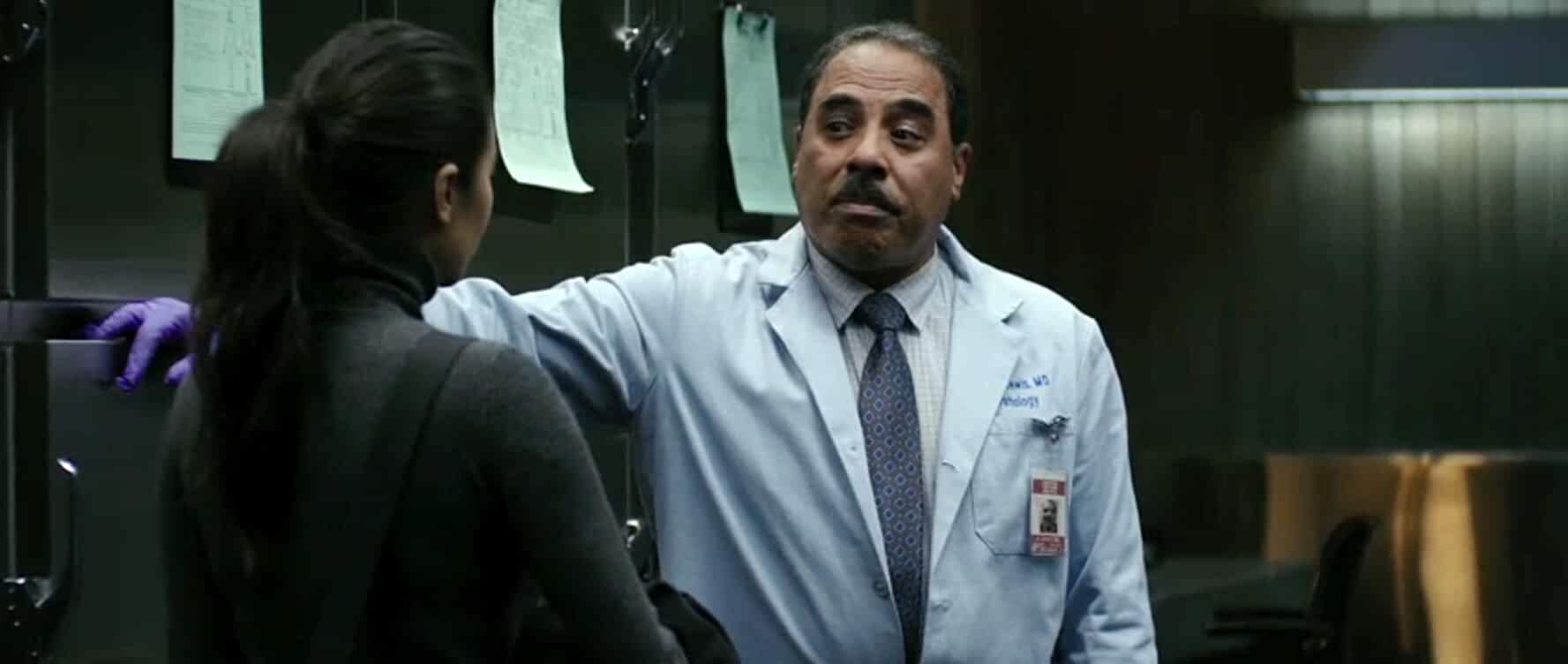 James A. Watson Jr. and Shay Mitchell in The Possession of Hannah Grace (2018)