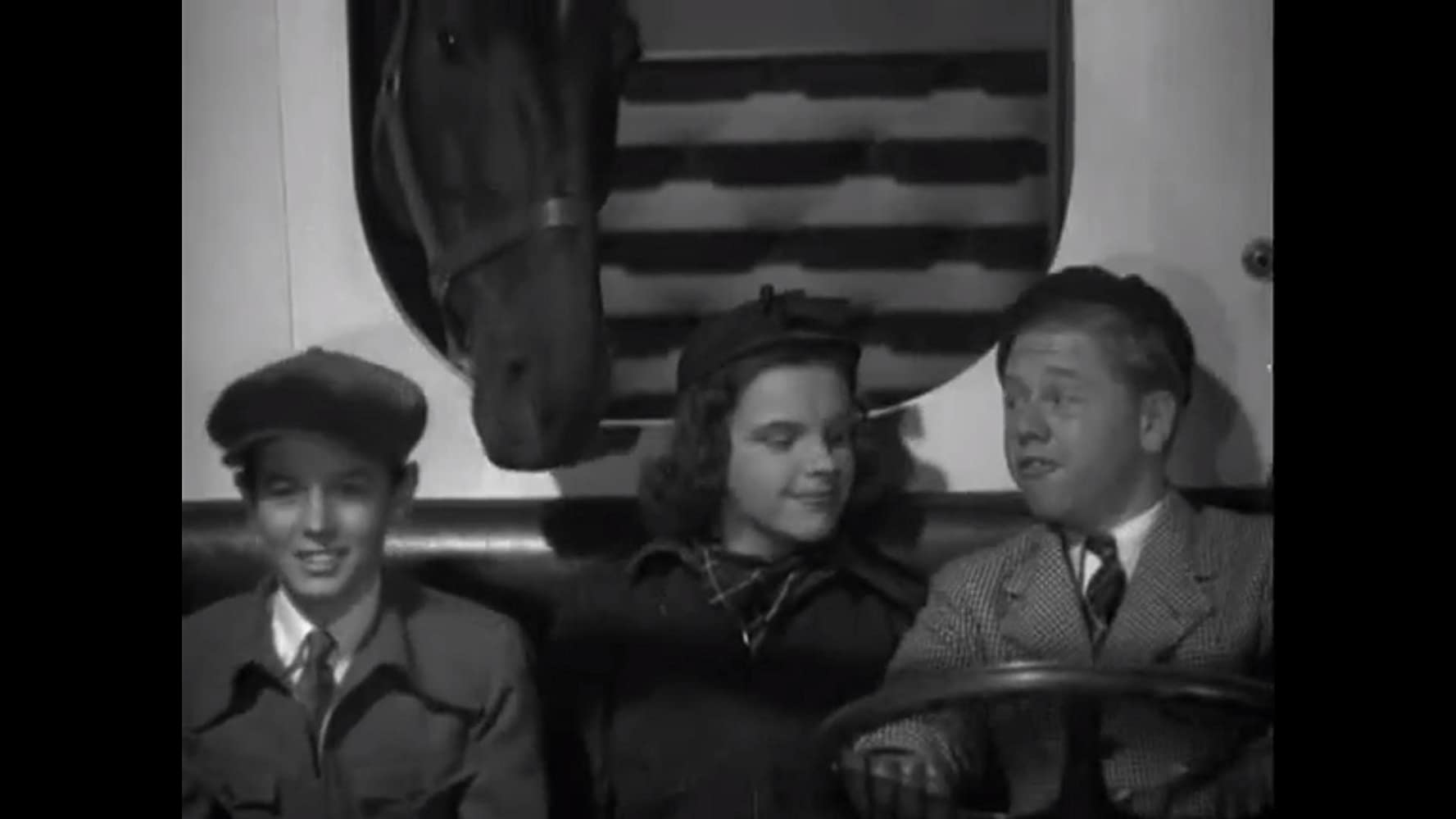 Judy Garland, Mickey Rooney, and Ronald Sinclair in Thoroughbreds Don't Cry (1937)