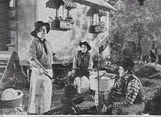 Smiley Burnette, Kenne Duncan, and Marshall Reed in The Laramie Trail (1944)