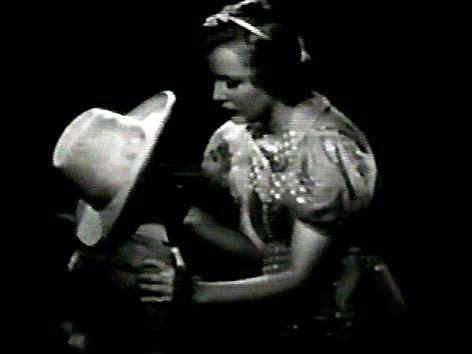 Muriel Evans and Richard Holland in Boss of Lonely Valley (1937)