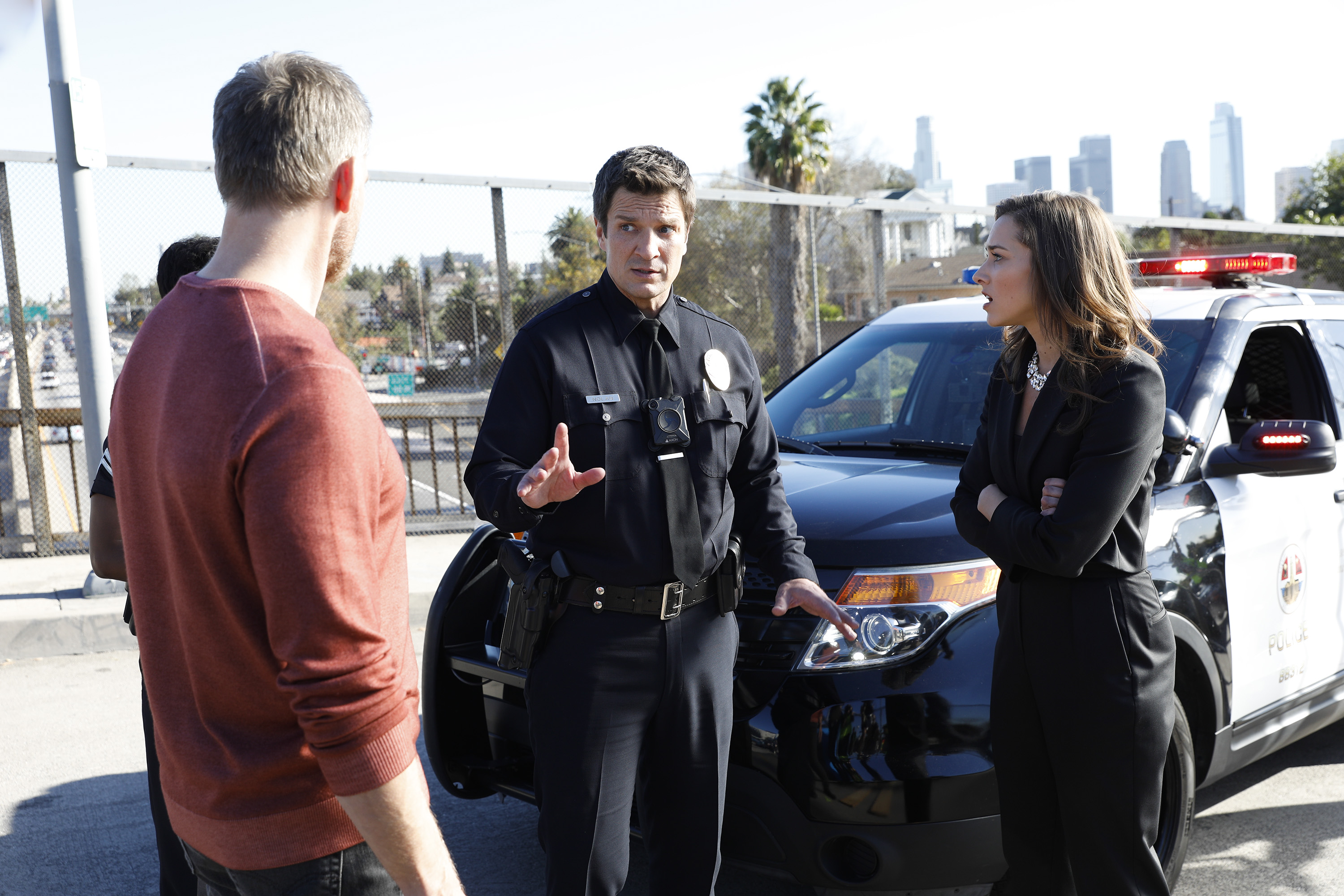Nathan Fillion and Rosslyn Luke in The Rookie (2018)