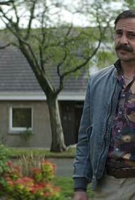 Emun Elliott in Episode 2 (2019)
