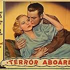 Shirley Grey and Neil Hamilton in Terror Aboard (1933)