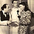 Ginger Rogers, Leon Belasco, and Eddie Conrad in Lucky Partners (1940)