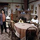 Bill Cosby, Keshia Knight Pulliam, and Phylicia Rashad in The Cosby Show (1984)