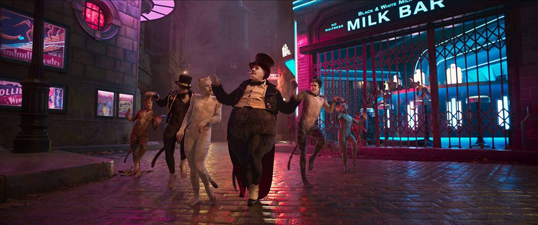 James Corden, Robbie Fairchild, Laurie Davidson, and Francesca Hayward in Cats (2019)