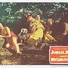 Lita Baron, Virginia Grey, Rick Vallin, Johnny Weissmuller, and Skipper in Jungle Jim (1948)