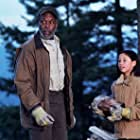 """Danny Glover as """"Jake"""" and Zoë Weizenbaum as """"Lenny"""" in WOODCUTTER."""