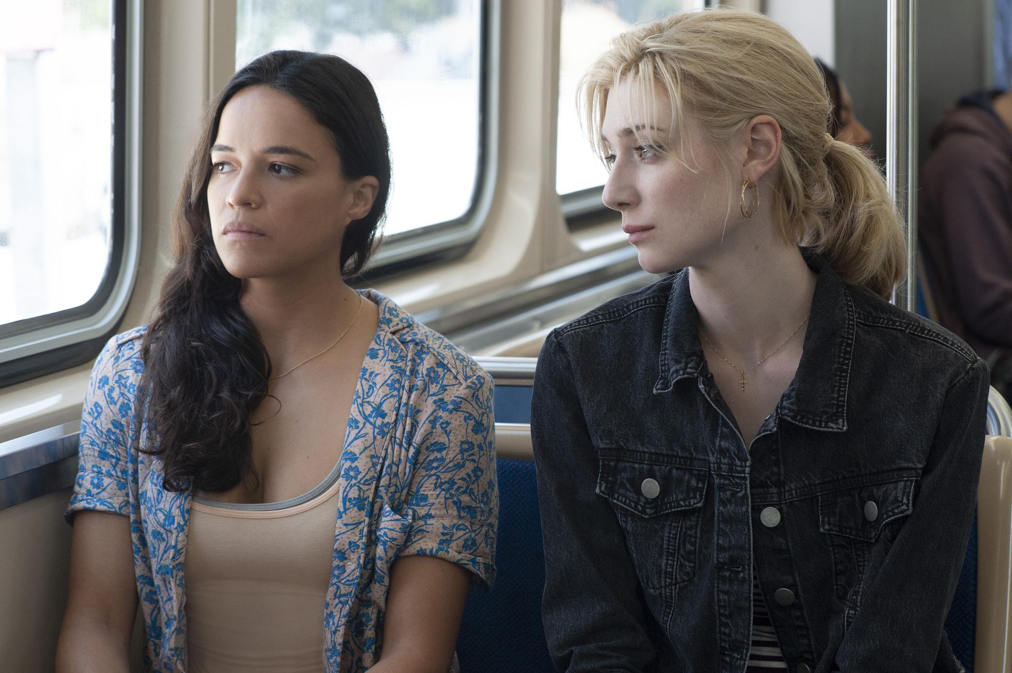 Michelle Rodriguez and Elizabeth Debicki in Widows (2018)