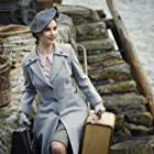 Lily James in The Guernsey Literary and Potato Peel Pie Society (2018)