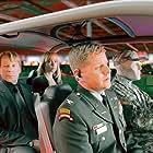 Bruce Willis, Michael Cudlitz, and Radha Mitchell in Surrogates (2009)