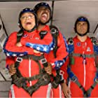 Martin Lawrence, Michael Landes, and Raven-Symoné in College Road Trip (2008)